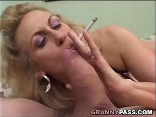 Smoking Mature Gives Blowjob To A Fat Cock